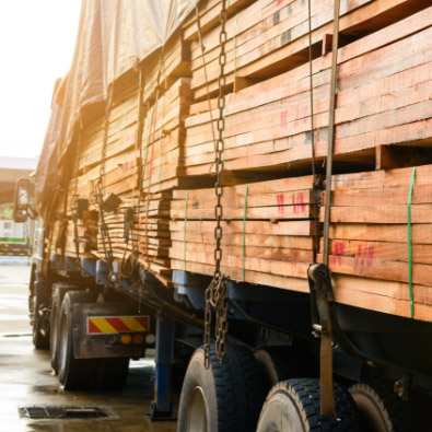 Flatbed truck carrying constuction wood